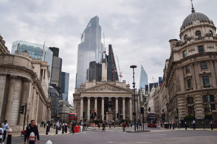 Bank of England downgrades growth projections, warns on inflation
