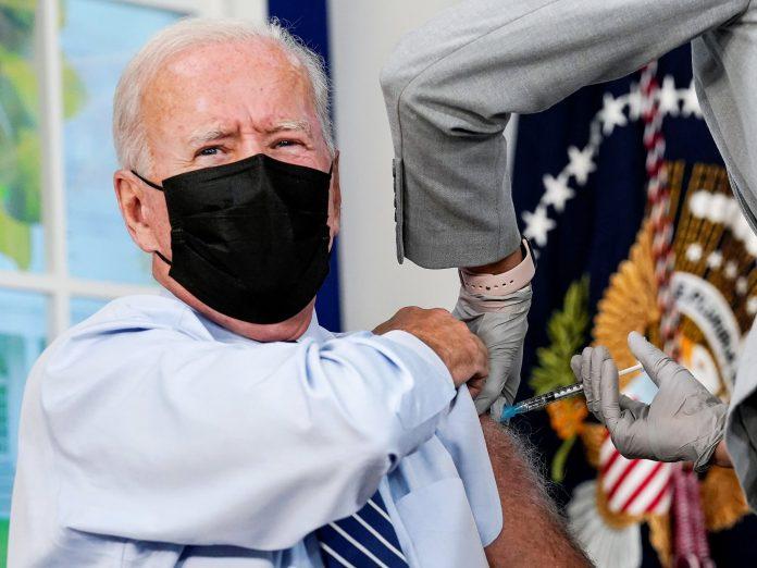 Biden receives Covid booster shot live on camera
