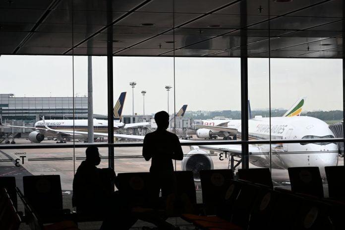 CDC raises Covid travel advisory level for Singapore, Hong Kong