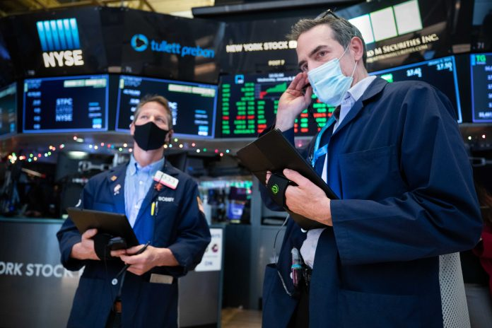 Dow gives up earlier gain, falls more than 100 points despite better-than-feared inflation report