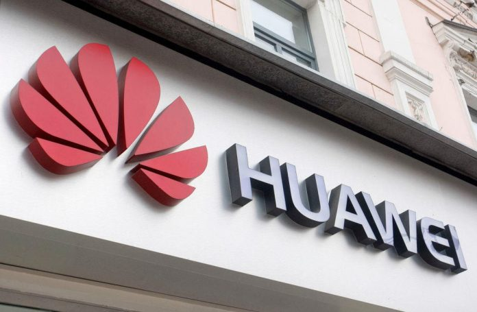 Huawei logo seen at the entrance to a Huawei brand store in