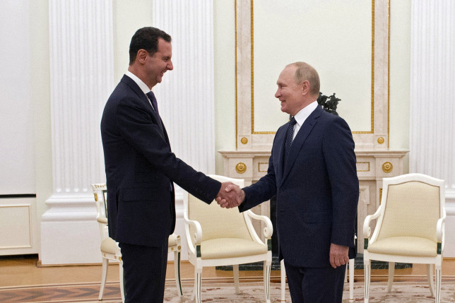 Russian President Vladimir Putin shakes hands with Syrian President Bashar al-Assad during a meeting at the Kremlin in Moscow, Russia, September 13, 2021.